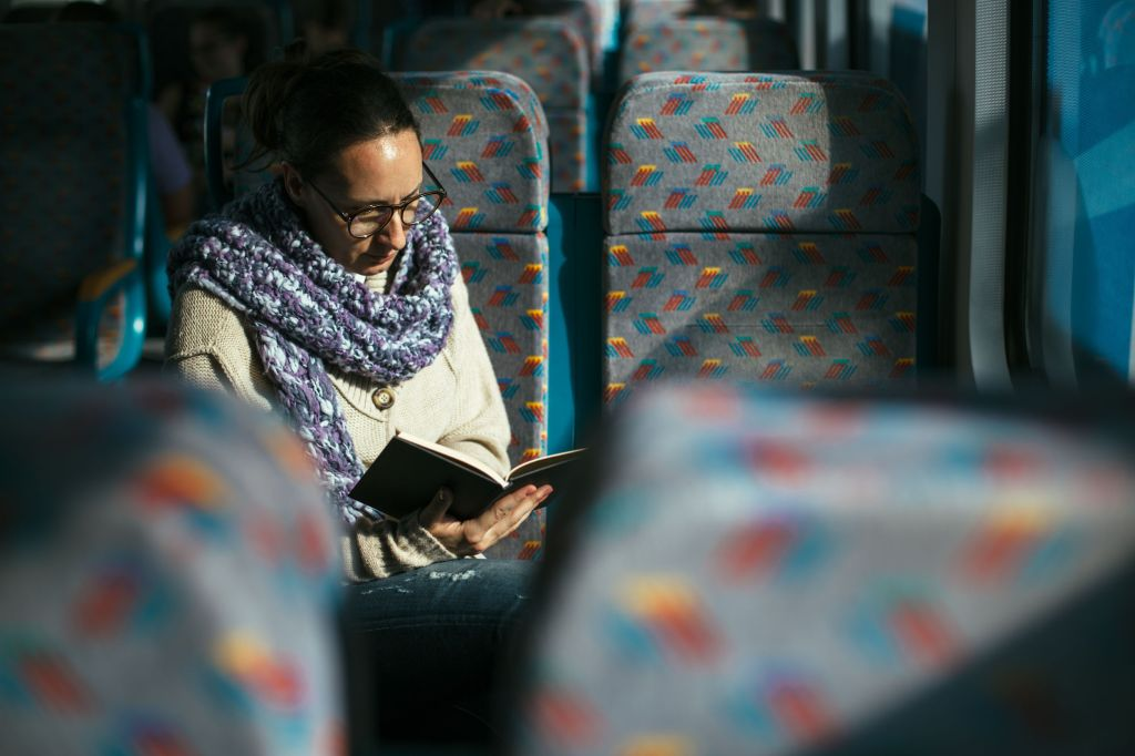 She would rather spend time reading book on the bus.
